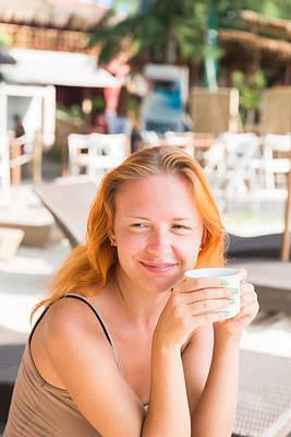 Animal Paintings David Stribbling - Young woman drinking coffee at the beach by Nikita Buida