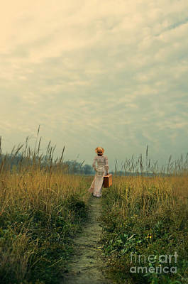 Prairie Girl Wall Art - Photograph - Young Woman Walking With A Suitcase On Country Path by Jill Battaglia