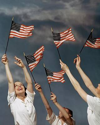 Photograph - Young Women Waving American Flags by Roger Kahan