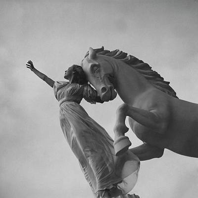 Look Away Photograph - Zorina With A Horse Statue by Toni Frissell