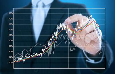 Businessman Writing Graph Of Stock Market  Art Print by Setsiri Silapasuwanchai