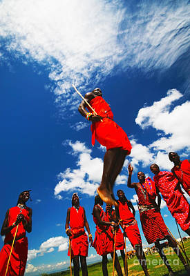 Photograph -  Masai Warriors Dancing Traditional Jumps by Anna Om