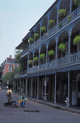 Musicians Royalty Free Images -  Musicians on Bourbon Street Royalty-Free Image by Carl Purcell