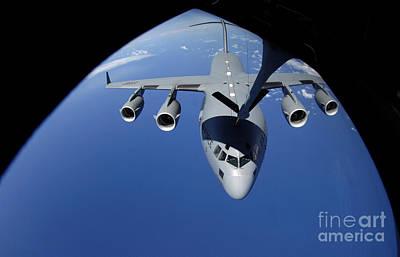 A C-17 Globemaster IIi Receives Fuel Art Print by Stocktrek Images