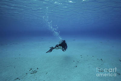 A Diver On A Scooter Explores The Clear Art Print