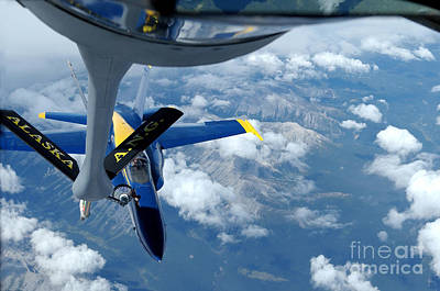A Kc-135 Stratotanker Refuels An Fa-18 Art Print by Stocktrek Images