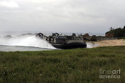 Knights Beach Photograph - A Landing Craft Air Cushion Comes by Stocktrek Images