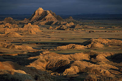 A Landscape Of Isolated Buttes And Rock Art Print by Annie Griffiths