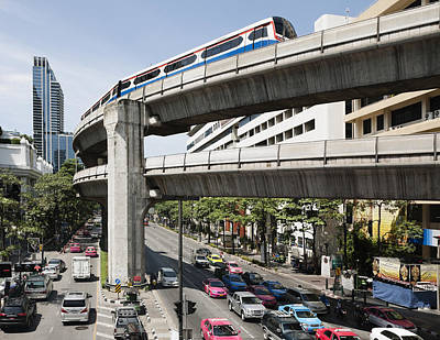 Traffic Congestion Photograph - A Mass Transit Train Travelling On An by Roberto Westbrook