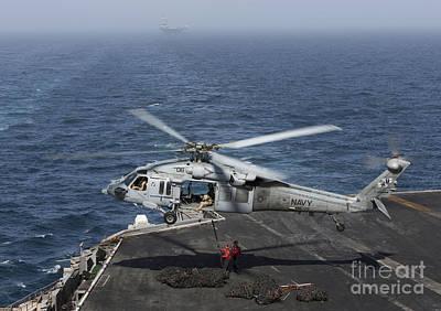 A Mh-60s Knighthawk Conducts A Vertical Art Print by Gert Kromhout