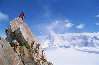 Tyree Photograph - A Mountain Climber Summits Mount by Gordon Wiltsie