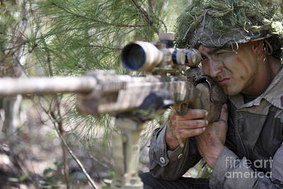 Photograph - A Sniper Sights In On A Target by Stocktrek Images