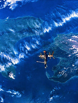 Space Ships Photograph - A Space Station In Orbit Above Earth by Stockbyte