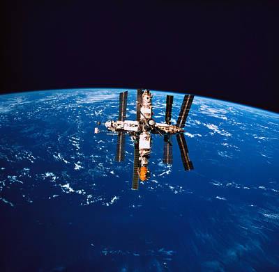 A Space Station In Orbit Above The Earth Art Print by Stockbyte