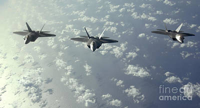 A Three-ship Formation Of F-22 Raptors Print by Stocktrek Images
