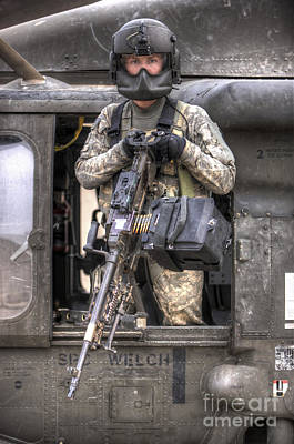 Photograph - A Uh-60 Black Hawk Door Gunner Manning by Terry Moore