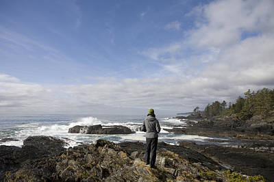 A Woman Stands On A Rocky Outcropping Art Print