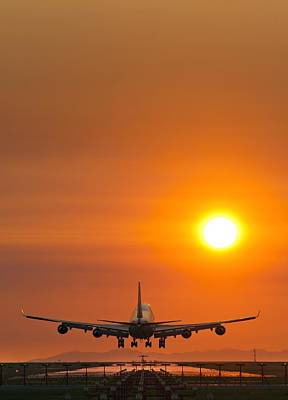 Passenger Plane Photograph - Aeroplane Landing At Sunset by David Nunuk