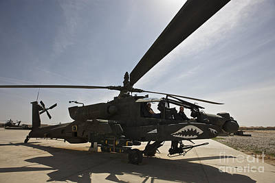 An Ah-64d Apache Helicopter Parked Art Print by Terry Moore