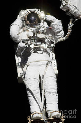 Grimm Fairy Tales Royalty Free Images - An Astronaut Anchored To A Mobile Foot Royalty-Free Image by Stocktrek Images