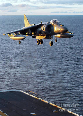 Av-8b Photograph - An Av-8b Harrier Prepares To Land by Stocktrek Images