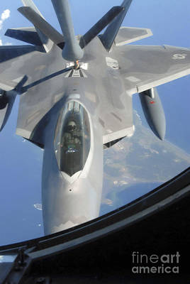 An F-22 Raptor Receives Fuel Art Print by Stocktrek Images