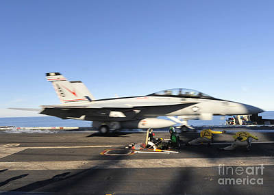 An Fa-18f Super Hornet Launches Art Print by Stocktrek Images
