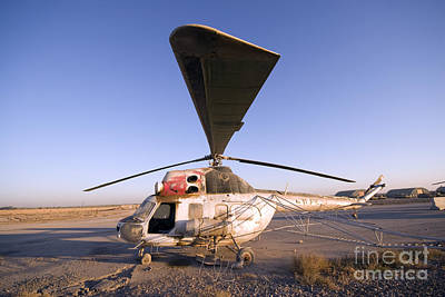 Abandoned Military Bases Photograph - An Iraqi Helicopter Sits On The Flight by Terry Moore
