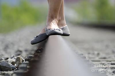 Balance On Railroad Tracks Art Print