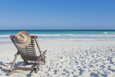 Beach Chair With A Hat, On An Empty Beach Print by Sasha Weleber