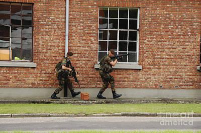 Belgian Soldiers On Patrol Art Print by Luc De Jaeger
