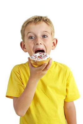 Donuts Photograph - Boy Eating A Doughnut by Ian Boddy