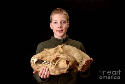 Boy Holding Kodiak Bear Skull Art Print