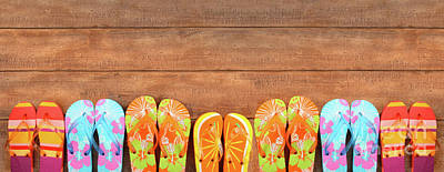 Brightly Colored Flip-flops On Wood  Art Print by Sandra Cunningham