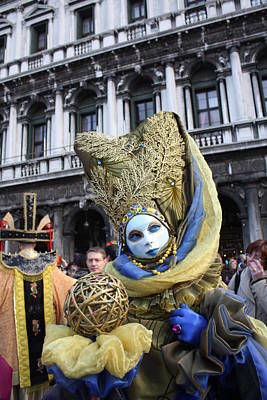Carnival-goer In Blue And Gold Print by Pam Blackstone
