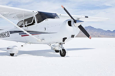 Cessna Aircraft On Bonneville Salt Flats Art Print by Paul Edmondson