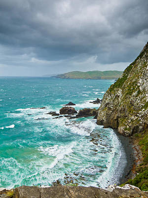 Cliffs Under Thunder Clouds And Turquoise Ocean Print by Ulrich Schade