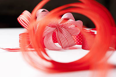 On Paper Photograph - Close Up Of Decorative Red Ribbons by Nils Hendrik Mueller