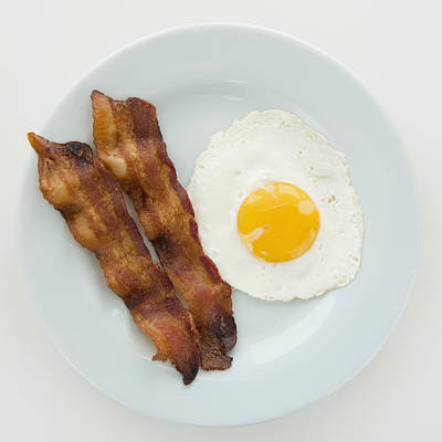 Sunny Side Up Photograph - Close Up Of Fried Egg With Bacon, Studio Shot by Jamie Grill