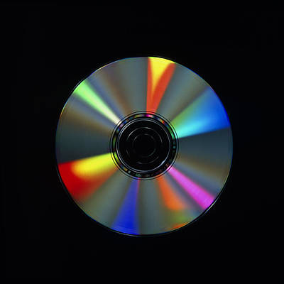 Compact Disc Photograph - Compact Disc With Light Interference Patterns by Damien Lovegrove