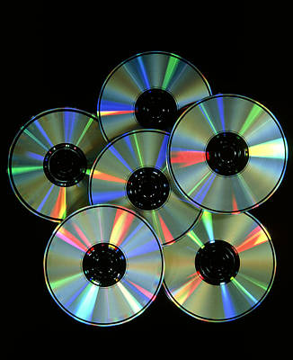 Compact Disc Photograph - Compact Discs With Light Interference Patterns by Damien Lovegrove