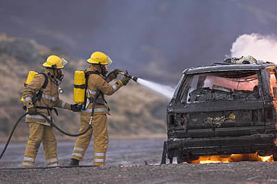 Firefighters Hosing A Burning Car Art Print