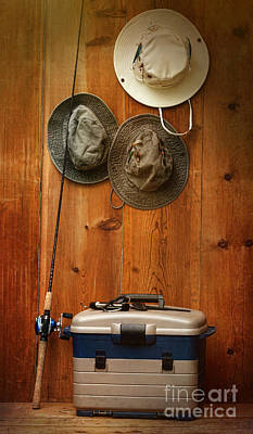 Photograph - Hats Hanging On Wall With Fishing Equipment by Sandra Cunningham