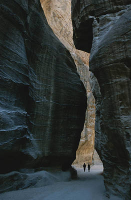 Hikers In The Siq Canyon Leading Art Print by Gordon Wiltsie