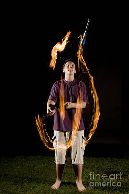 Juggling Fire Print by Ted Kinsman