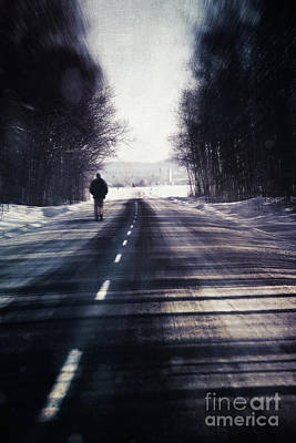 Man Walking On A Rural Winter Road Art Print by Sandra Cunningham