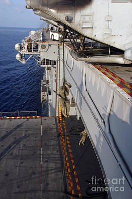 Overhang Photograph - Marines And Sailors Fast-rope by Stocktrek Images