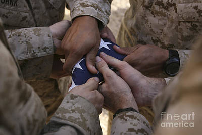 Photograph - Marines Fold An American Flag by Stocktrek Images