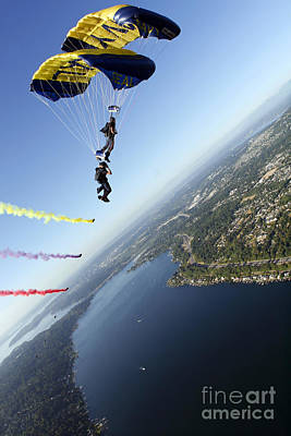 Leap Frog Photograph - Members Of The U.s. Navy Parachute by Stocktrek Images