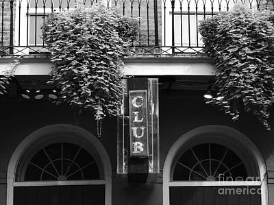 Photograph - Neon Club Sign Bourbon Street Corner French Quarter New Orleans Black And White by Shawn O'Brien